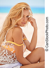 Close up portrait of blond girl on the beach