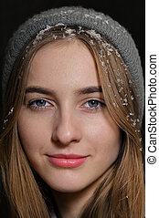 Portrait Of Blue-Eyed Girl With Snow In Hair
