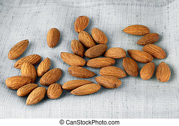 close up portrait of Burlap sack with almonds spilling out
