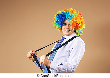Close-up Portrait of business man in clown wig