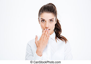 Close-up portrait of a young beautiful businesswoman covering her mouth with palm isolated on a white background