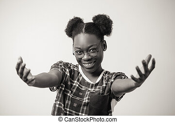 close up portrait of cheerful African female showing kindness and politeness