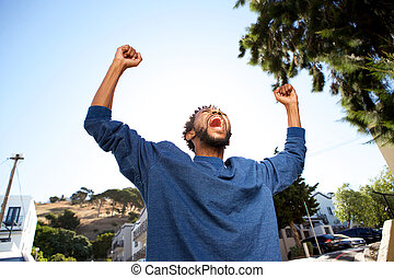 cheerful man with arms outstretched