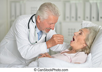 Close up portrait of confident doctor with senior patient