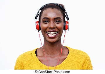cool african american woman listening to music with headphones