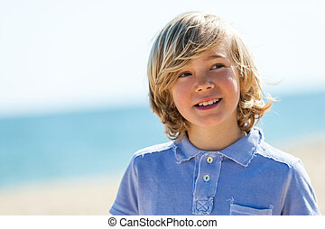 Close up portrait of cute boy outdoors.