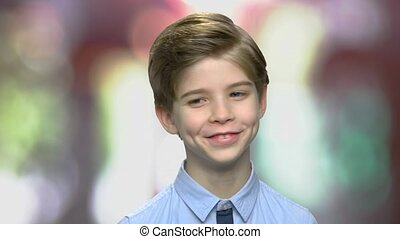 Close up portrait of cute smiling boy.