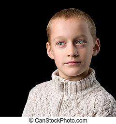 Close up portrait of cute teenage boy