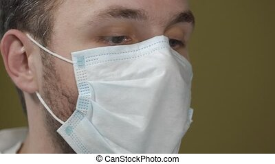 Close up portrait of dentist wearing mask during operation.