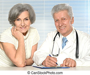 Close-up portrait of elderly doctor with a patient