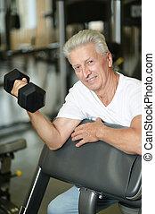 Close up portrait of elderly man in gym