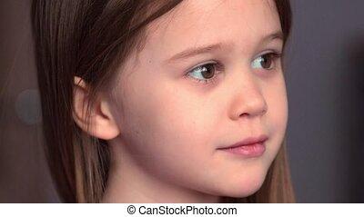 Close up portrait of emotional little girl