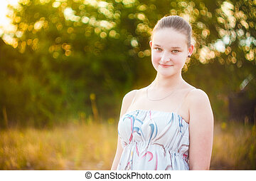 Close up portrait of face young beautiful girl woman on green outdoor background summer nature