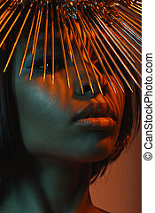 close up portrait of fashionable african american woman in headpiece with needles