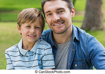 Close-up portrait of father and boy at park