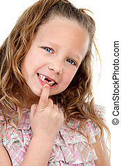 Close up portrait of girl showing missing teeth.