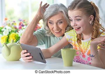 Close up portrait of girl sitting at table with laptop -...