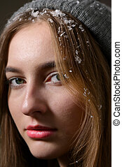 Close-Up Portrait Of Girl With Snow In Hair