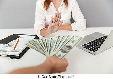 Close up portrait of hand holding cash
