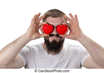 Close-up portrait of handsome bearded man closing eyes by red  hearts, isolated on white