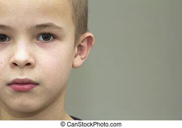 Close up portrait of handsome little boy. Part view