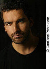 close-up portrait of handsome man - Shadowy dark close-up...