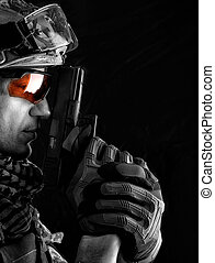 handsome military man with hand gun