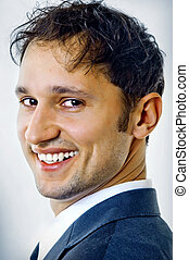 Close-up portrait of handsome young business man