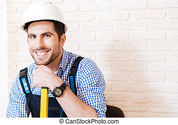 Close-up portrait of handyman with a hard hat