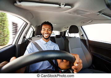 happy african american man with beard driving car