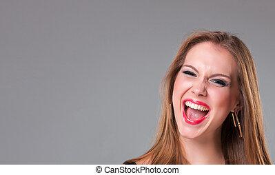 Close-up portrait of happy beautiful girl