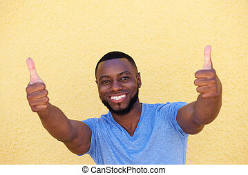 happy successful man with two thumbs up