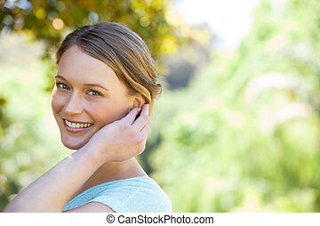 Close-up portrait of happy woman in park