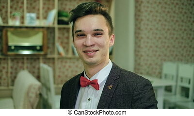 Close-up portrait of happy young man smiling at camera good