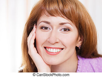 Close up portrait of happy young woman