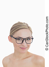 Close-up portrait of happy young woman wearing glasses
