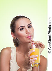 Close-up portrait of happy young woman with juice. Concept vegetarian dieting - healthy food
