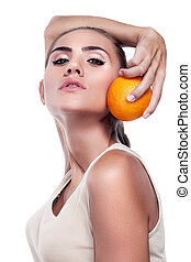 Close-up portrait of happy young woman with juice on white background.  Concept vegetarian dieting - healthy food