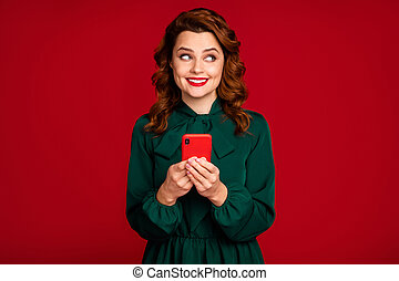 Close-up portrait of her she nice attractive charming cheerful curious wavy-haired girl using cell internet online isolated on bright vivid shine vibrant red maroon burgundy marsala color background