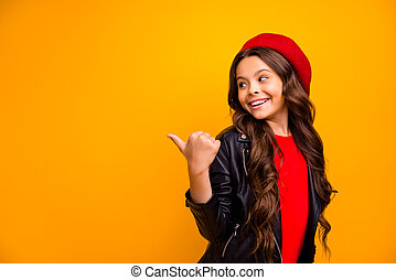 Close-up portrait of her she nice attractive charming glad cheerful long-haired girl pointing thumb back recommend solution copy space isolated over bright vivid shine vibrant yellow color background