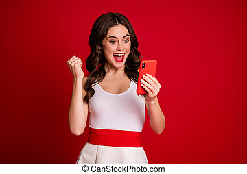 Close-up portrait of her she nice attractive lovely cheerful cheery wavy-haired girl using cell having fun isolated on bright vivid shine vibrant red burgundy marsala maroon color background