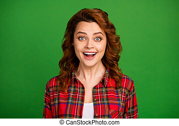 Close-up portrait of her she nice attractive lovely pretty amazed cheerful cheery wavy-haired girl wearing checked shirt great news isolated over bright vivid shine vibrant green color background