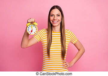 Close-up portrait of her she nice attractive lovely pretty charming cheerful cheery girl holding in hands childish retro clock isolated over pink pastel color background