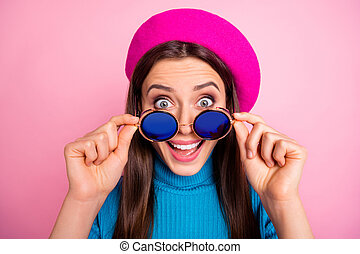 Close-up portrait of her she nice attractive lovely pretty charming crazy overjoyed cheerful cheery girl touching specs unbelievable news isolated over pink pastel color background