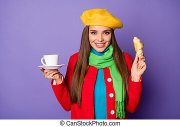Close-up portrait of her she nice attractive lovely pretty cheerful cheery straight-haired girl having lunch meal aromatic croissant isolated on lilac purple violet pastel color background