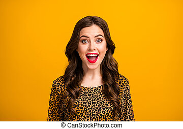 Close-up portrait of her she nice-looking attractive lovely pretty amazed cheerful cheery wavy-haired girl fan good news reaction isolated on bright vivid shine vibrant yellow color background