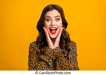 Close-up portrait of her she nice-looking attractive lovely pretty amazed delighted cheerful cheery wavy-haired girl good news reaction isolated on bright vivid shine vibrant yellow color background