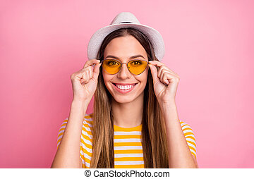 Close-up portrait of her she nice-looking attractive lovely pretty winsome content cheerful cheery girl touching specs isolated over pink pastel color background