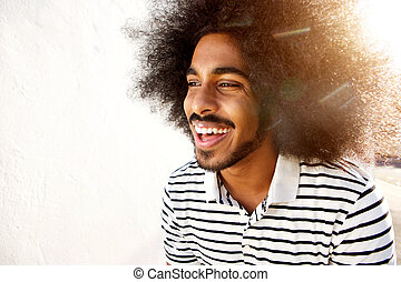 laughing afro man in sunlight