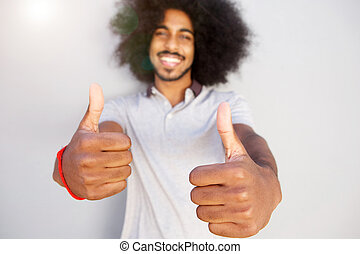 laughing afro man with two thumbs up